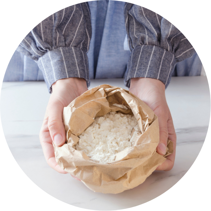 hands holding bag of flour